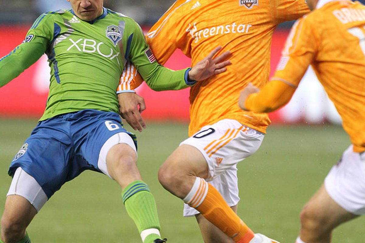 SEATTLE - MARCH 25:  Geoff Cameron #20 of the Houston Dynamo battles Osvaldo Alonso #6 of the Seattle Sounders FC at Qwest Field on March 25, 2011 in Seattle, Washington. (Photo by Otto Greule Jr/Getty Images)