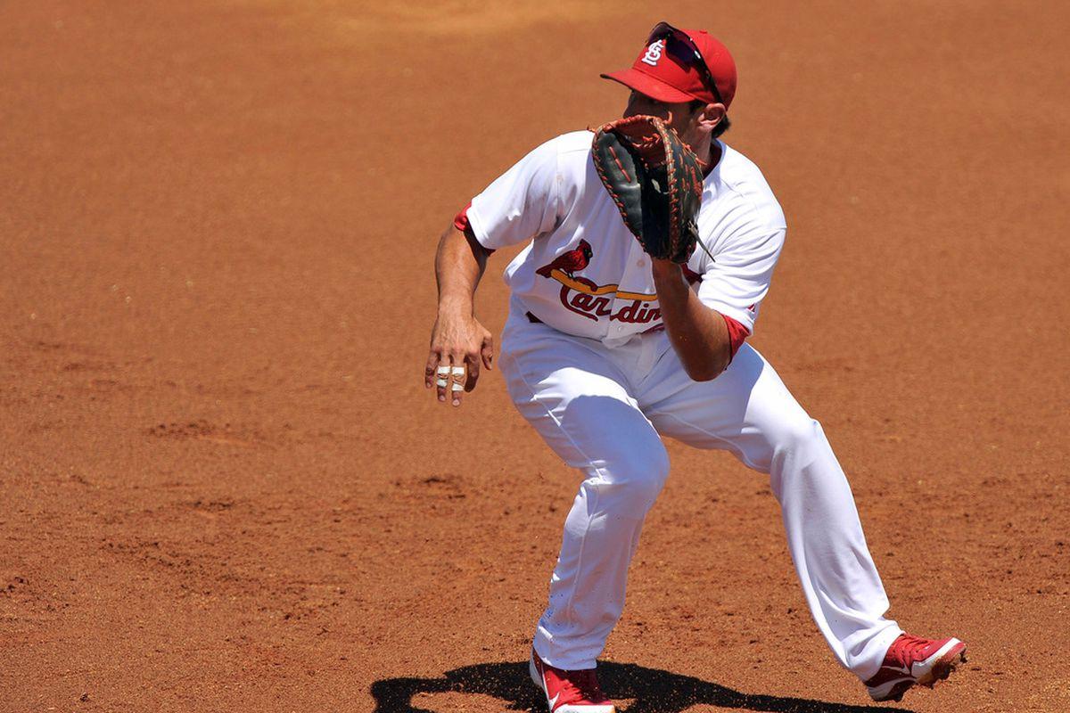 March 26, 2012; Jupiter, FL, USA;   St. Louis Cardinals first baseman Matt Carpenter (62) makes a play during a spring training game against the New York Mets at Roger Dean Stadium. Mandatory Credit: Brad Barr-US PRESSWIRE