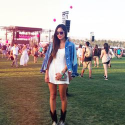 Aimee in Coachella look number two: an Armani Exchange jacket, a Lovers + Friends lace romper, vintage boots and a Loeffler Randall bag.