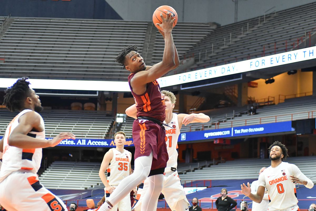 Virginia Tech Hokies forward Justyn Mutts grabs a rebound against the Syracuse Orange in the second half at the Carrier Dome.