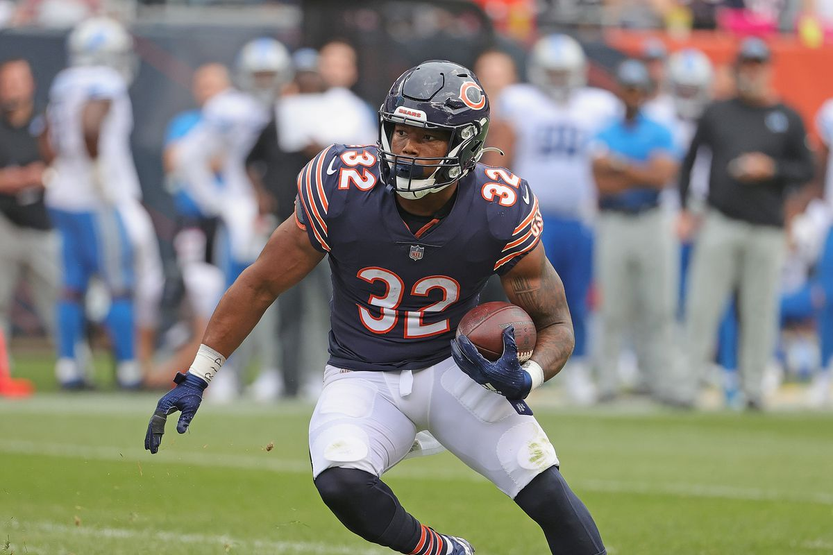 David Montgomery #32 of the Chicago Bears runs for a touchdown against the Detroit Lions at Soldier Field on October 03, 2021 in Chicago, Illinois. The Bears defeated the Lions 24-14.