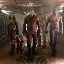 """This image released by Disney - Marvel shows, from left, Zoe Saldana, the character Rocket Racoon, voiced by Bladley Cooper, Chris Pratt, the character Groot, voiced by Vin Diesel and Dave Bautista in a scene from """"Guardians Of The Galaxy."""""""