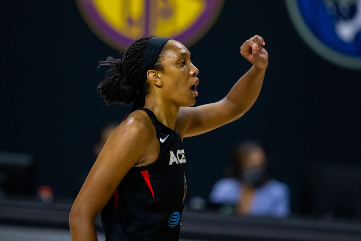 Las Vegas Aces center A'ja Wilson talks with teammates during game two of the 2020 WNBA Finals at IMG Academy.