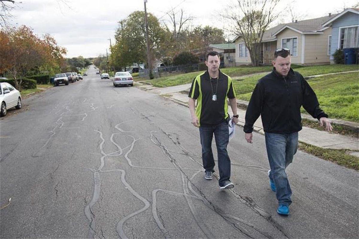 San Antonio police officers Ernie Stevens, left, and Joe Smarro
