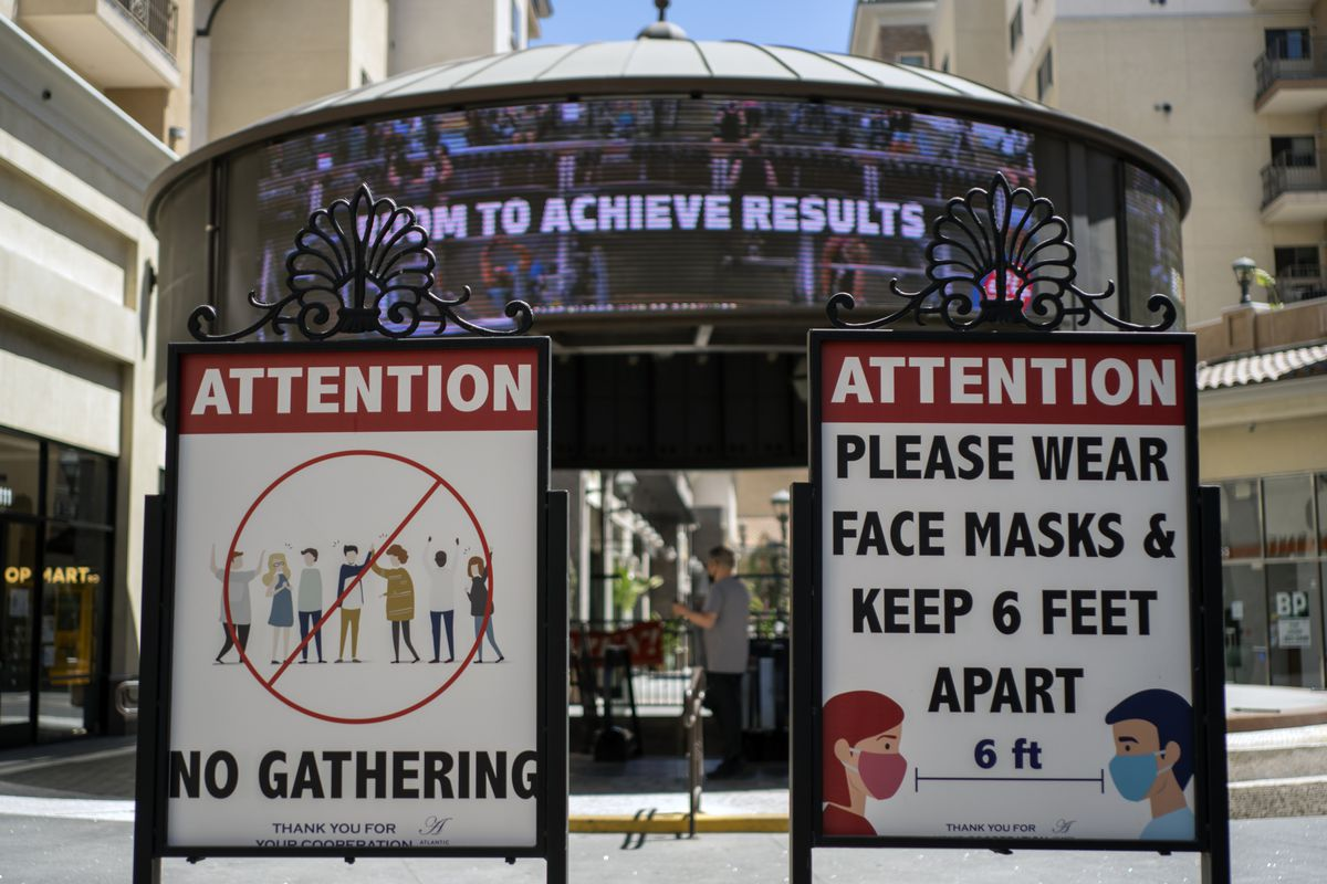 Signs with social distancing guidelines and face mask requirements in Los Angeles