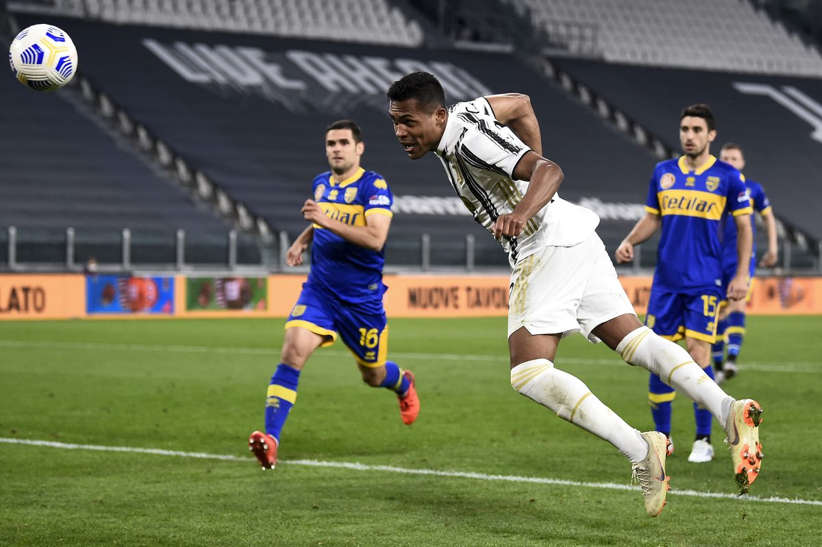 Alex Sandro of Juventus FC scores a goal from a header...