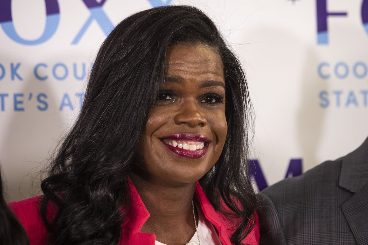 Cook County State's Attorney Kim Foxx poses for a photo with family members after finishing her election night headquarters speech at the Kinzie Hotel.