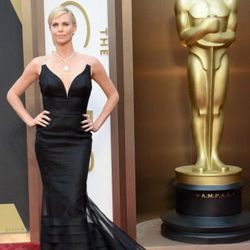 Charlize Theron looking incredible in dramatic Dior.