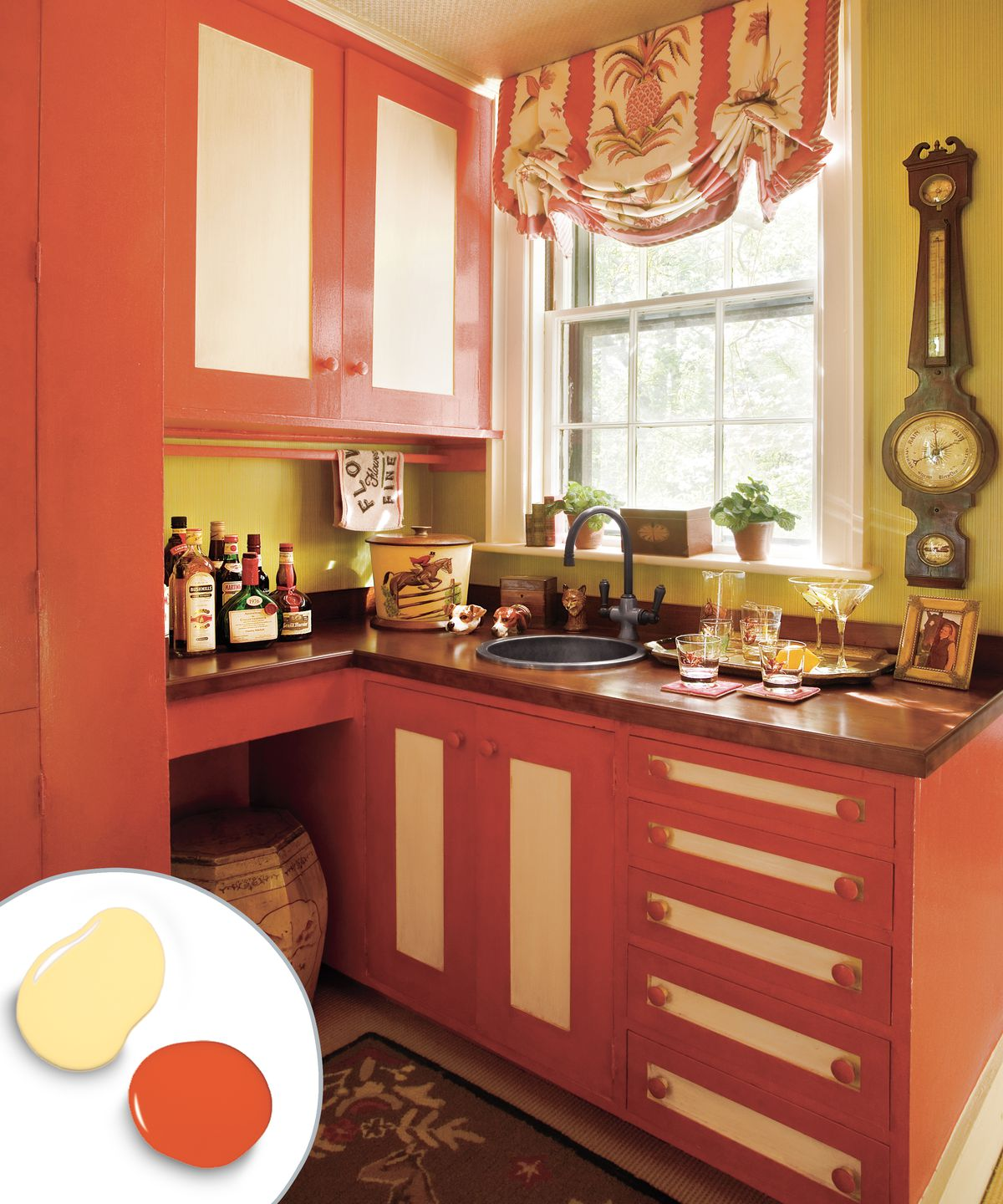 Two toned kitchen cabinet with red cabinets and yellow panels.