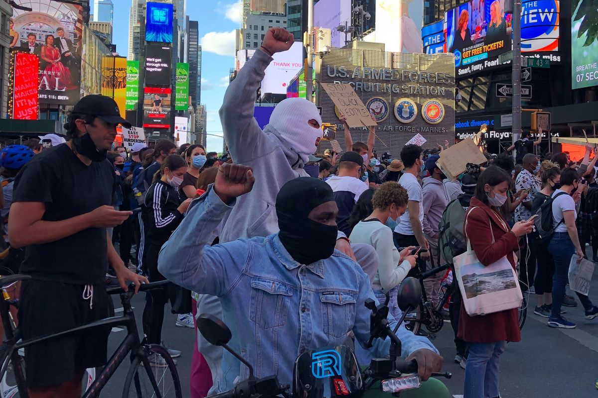 Protesters march through Time Square on May 31, 2020.