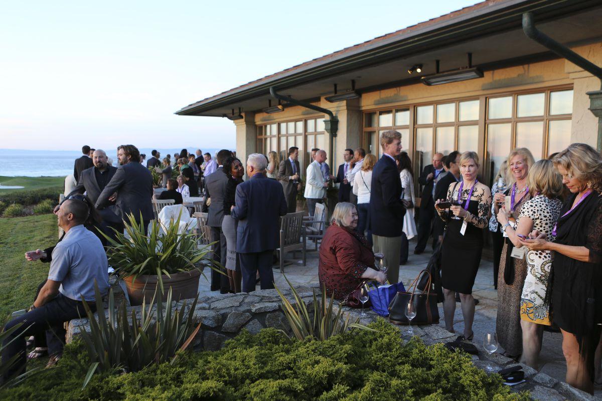 A crowd drinks wine at Pebble Beach Food & Wine