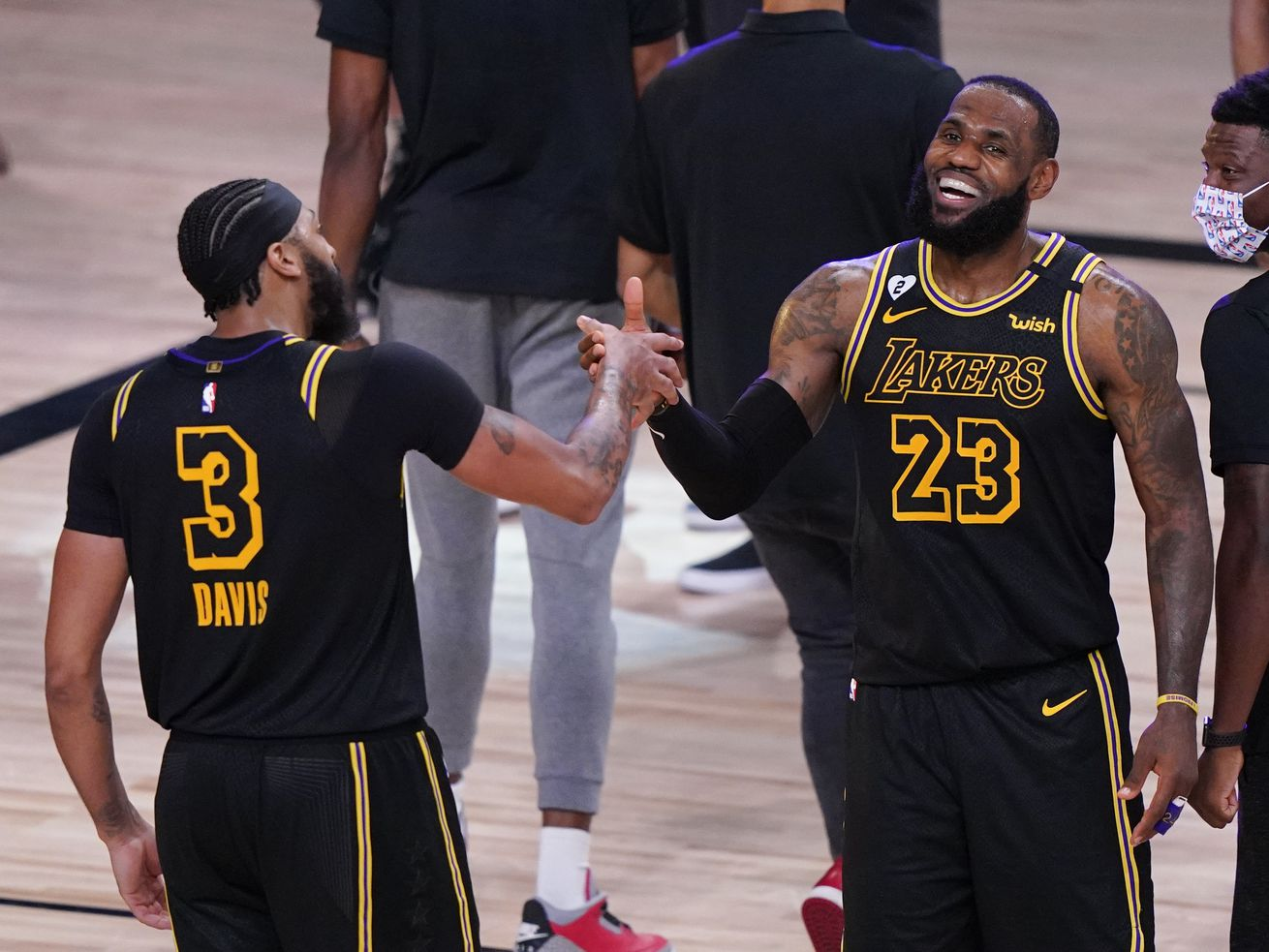 In this Sunday, Sept. 20, 2020, file photo, Los Angeles Lakers' LeBron James (23) celebrates with teammate Anthony Davis (3) after an NBA conference final playoff basketball game against the Denver Nuggets in Lake Buena Vista, Fla. The Lakers won 105-103.