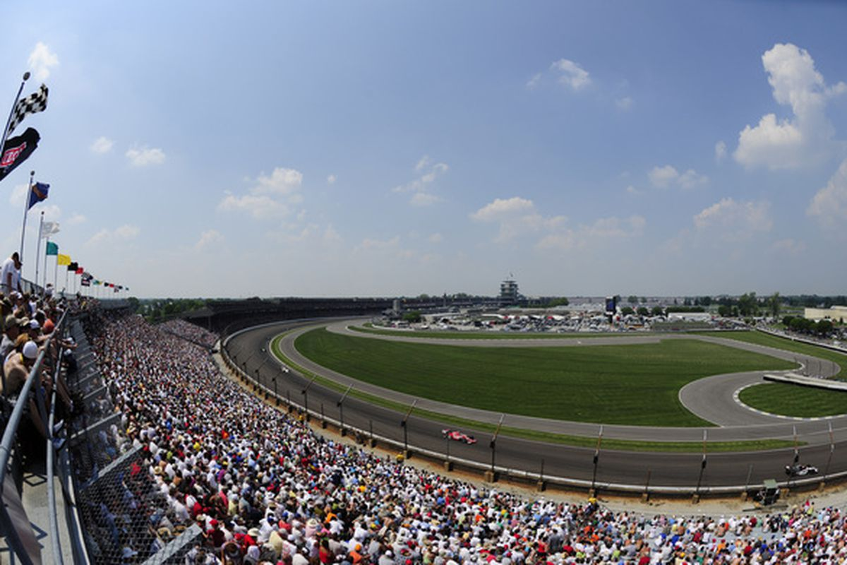 INDIANAPOLIS - MAY 30:  Cars race during the IZOD IndyCar Series 94th running of the Indianapolis 500 at the Indianapolis Motor Speedway on May 30, 2010 in Indianapolis, Indiana.  (Photo by Robert Laberge/Getty Images)