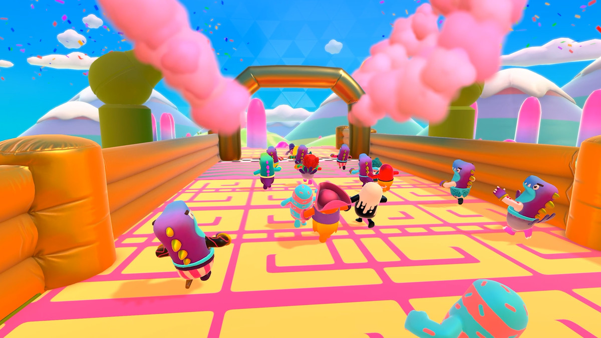 A colorful swarm of jelly bean-shaped guys run towards an exit