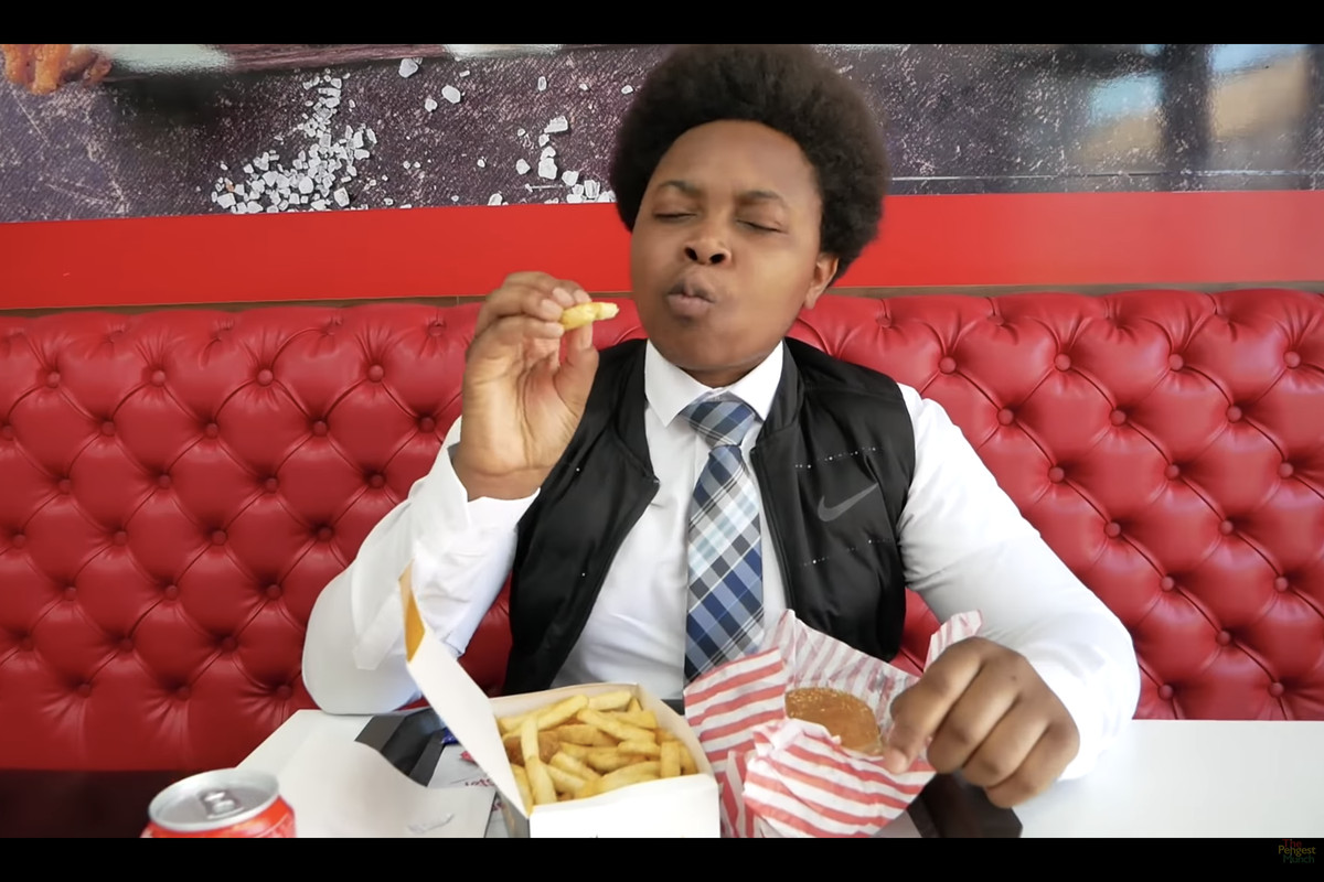The Chicken Connoisseur, Elijah Quashie, closes his eyes in ecstasy at some outstanding chips on The Pengest Munch