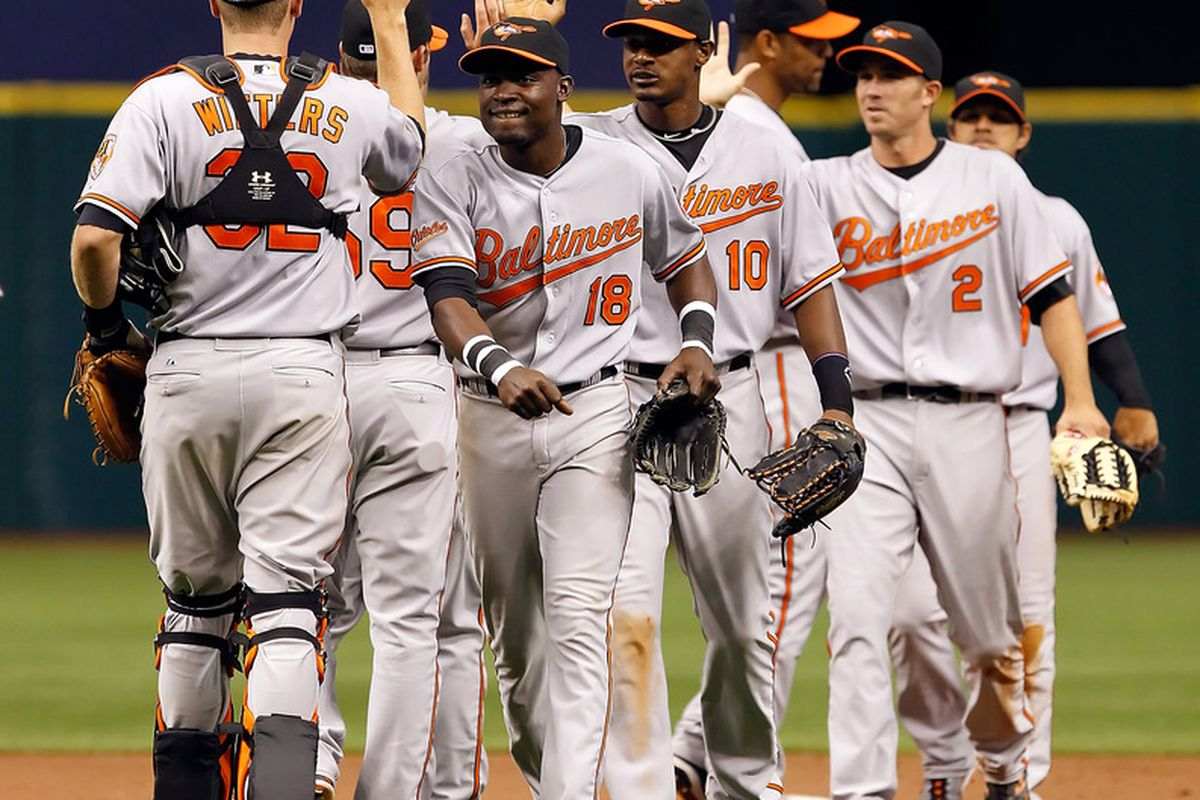 ST. PETERSBURG, FL - APRIL 03:  Outfielders Felix Pie and Adam Jones #10 of the Baltimore Orioles celebrate their team's victory over the Tampa Bay Rays at Tropicana Field on April 3, 2011 in St. Petersburg, Florida.  (Photo by J. Meric/Getty Images)