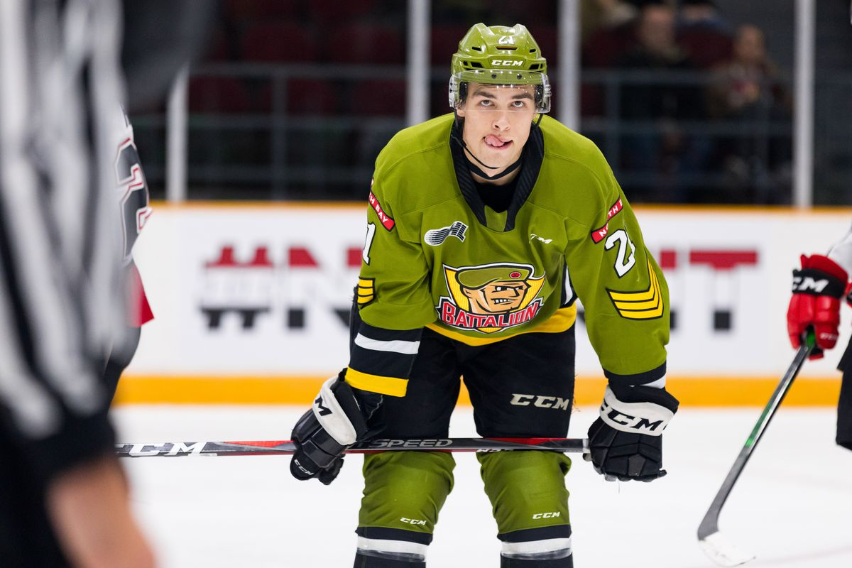 North Bay Battalion Right Wing Brandon Coe (21) waits for a face-off during Ontario Hockey League action between the North Bay Battalion and Ottawa 67's on December 1, 2019, at TD Place Arena in Ottawa, ON, Canada.