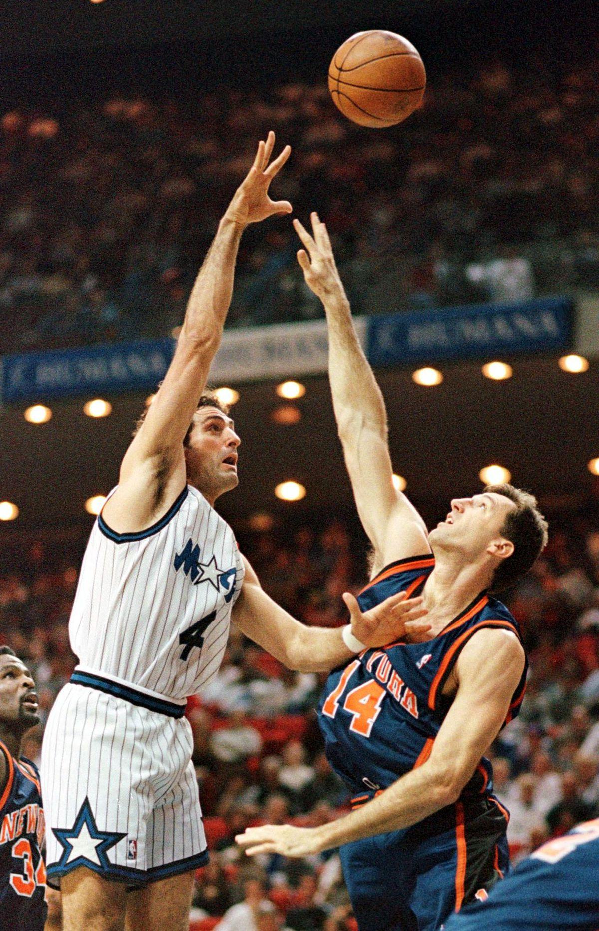 Orlando Magic center (4) Rony Seikaly goes over th