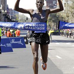 Wesley Korir of Kenya crosses the finish line to win the men's division of the 2012 Boston Marathon in Boston, Monday, April 16, 2012. (AP Photo/Elise Amendola)