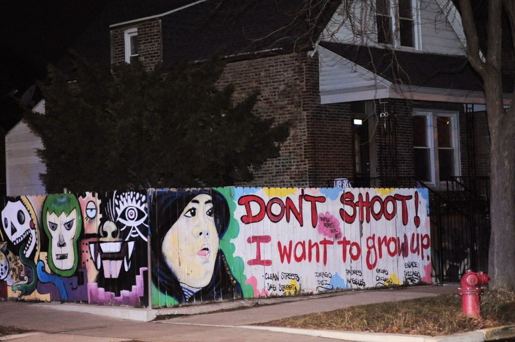 """Across the corner of 27th and Avers, from where a 2-year-old boy was killed on Wednesday, a graffiti mural in sad irony states """"I want to grow up.""""   John Booz/For the Sun Times"""