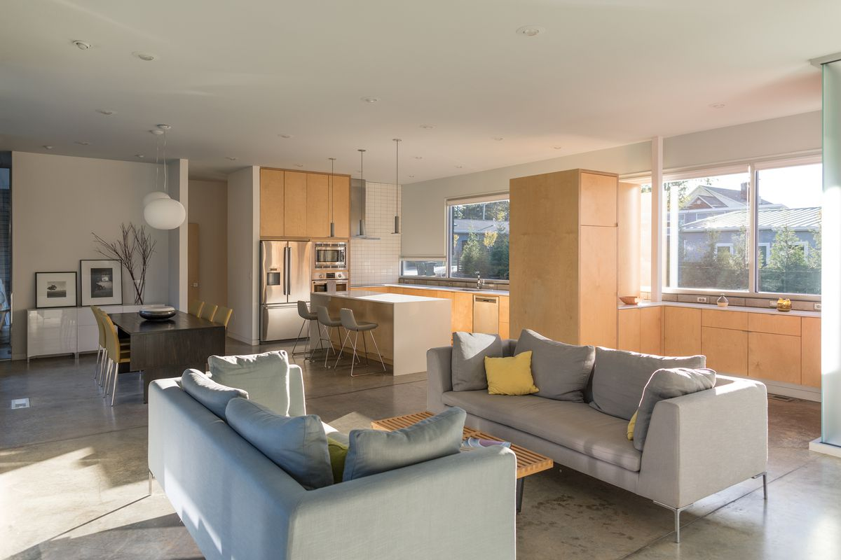 The living room, dining room, and kitchen are in one open space.