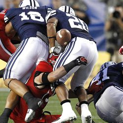 Utah Utes linebacker Chaz Walker (32) forces Brigham Young Cougars running back Joshua Quezada (20) to fumble as the University of Utah and Brigham Young University play football Saturday, Sept. 17, 2011, in Provo, Utah.