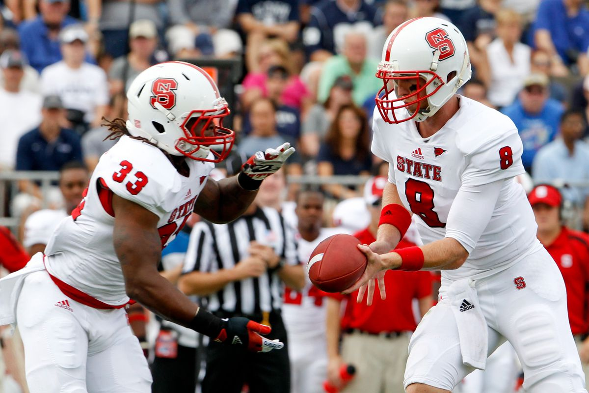 Sep 8, 2012; East Hartford, CT, USA; North Carolina State Wolfpack quarterback Mike Glennon (8) hands off the ball to running back Mustafa Greene (33) during the first quarter at Rentschler Field. Mandatory Credit: David Butler II-US PRESSWIRE