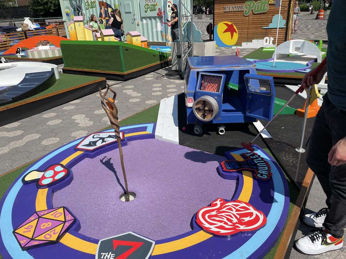 a minigolf hole that is a van that leads into a DnD style sorta situation on the bottom with a magical staff and dice