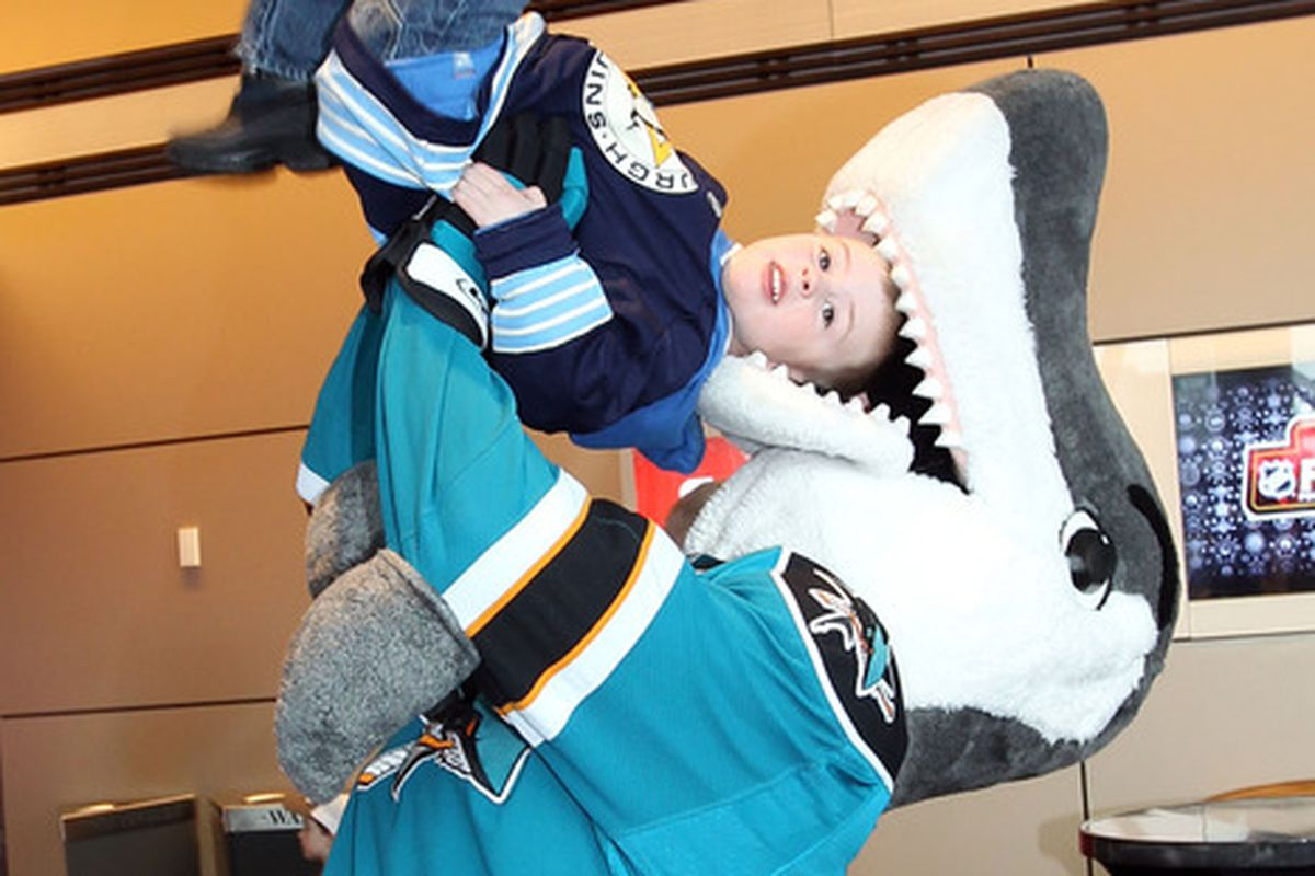 OTTAWA, ON - JANUARY 27:  San Jose Sharks mascot S.J. Sharkie poses with Ethan Bathurst of Ottawa during the NHL Fan Fair at the Ottawa Convention Centre on January 27, 2012 in Ottawa, Ontario, Canada.  (Photo by Bruce Bennett/Getty Images)