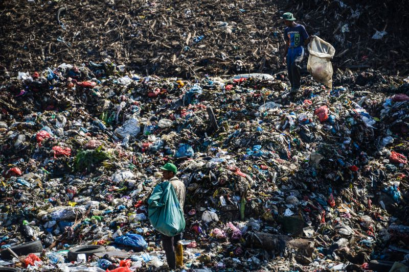 Scavengers collect plastic materials at a garbage dump in Banda Aceh, Indonesia.