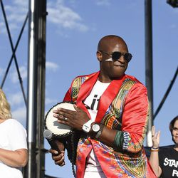 Emcee Alex Boye plays a drum as he announces the Mama Dragons during the LoveLoud Festival at Utah Valley University on Saturday, Aug. 26, 2017, in Orem.