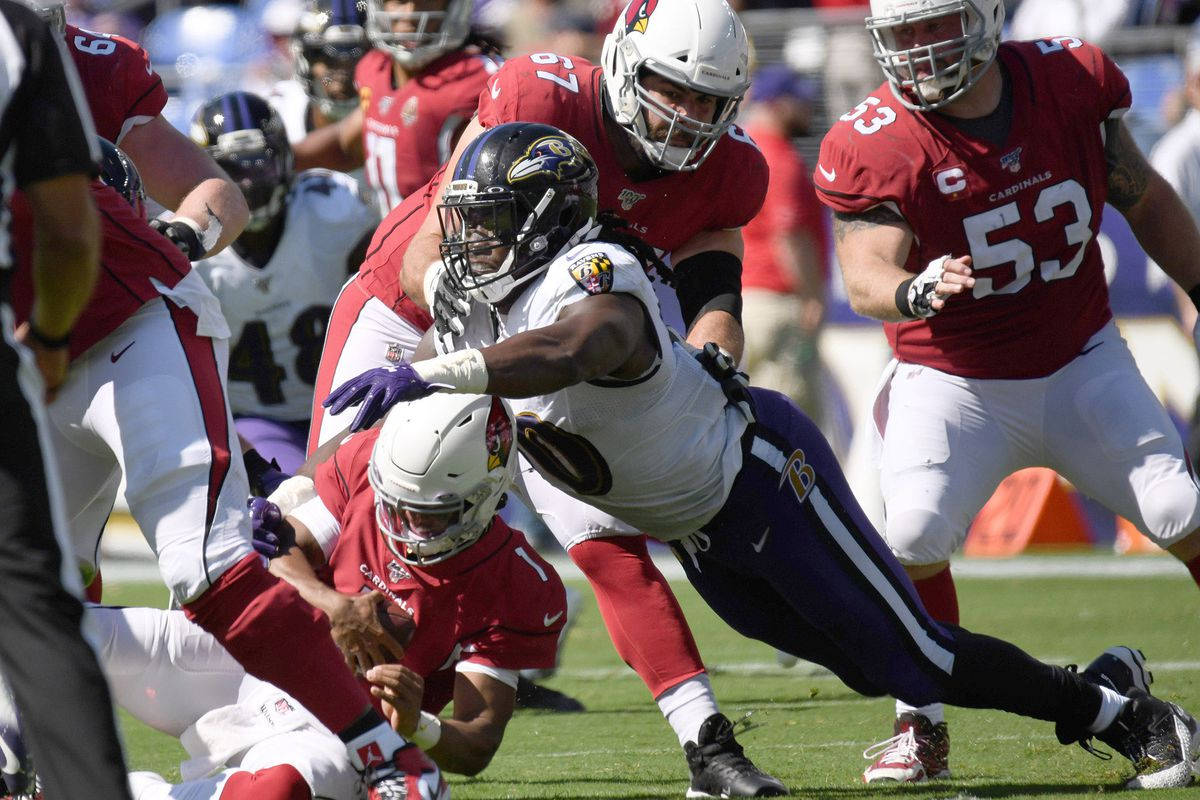 Baltimore Ravens' Pernell McPhee, right, sacks Arizona Cardinals quarterback Kyler Murray in the first half on Sunday, Sept. 15, 2019 at M & T Bank Stadium in Baltimore, MD.