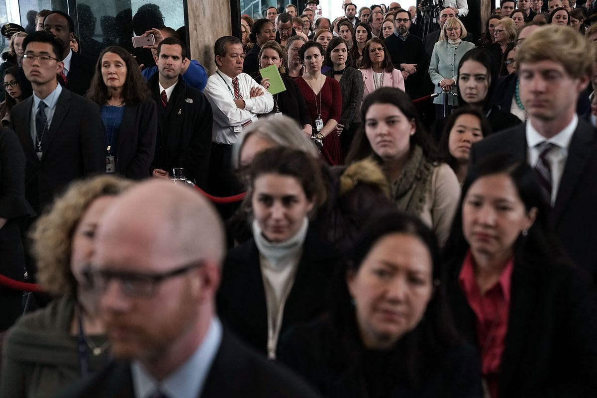 State Department employees listen to former Secretary of State Rex Tillerson's farewell remarks on March 22, 2018.