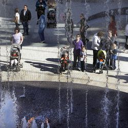 People enjoy the fountains as City Creek Center opens in Salt Lake City, Thursday, March 22, 2012.