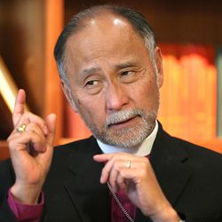 Bishop Scott B. Hayashi talks about his recent journey to Cuba with Craig Wirth, spokesman for the Episcopal Diocese of Utah, April 21, 2015, in Salt Lake City.