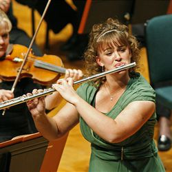Gabriella Roderer plays George Hue's Fantaisie for Flute and Orchestra during the 50th anniversary Salute to Youth concert Tuesday in Salt Lake City.