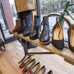 There are also women's heels and ankle boots from brands such as Acne. And, that Shiola bike in the window is for sale, too.