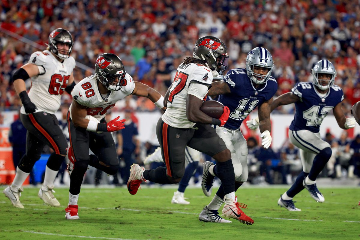 Ronald Jones II #27 of the Tampa Bay Buccaneers carries the ball during the first quarter against the Dallas Cowboys at Raymond James Stadium on September 09, 2021 in Tampa, Florida.