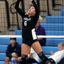 West Jordan's Ianella Morillo sets the ball during a high school volleyball game against Woods Cross at West Jordan High School in West Jordan on Thursday, Sept. 2, 2021.