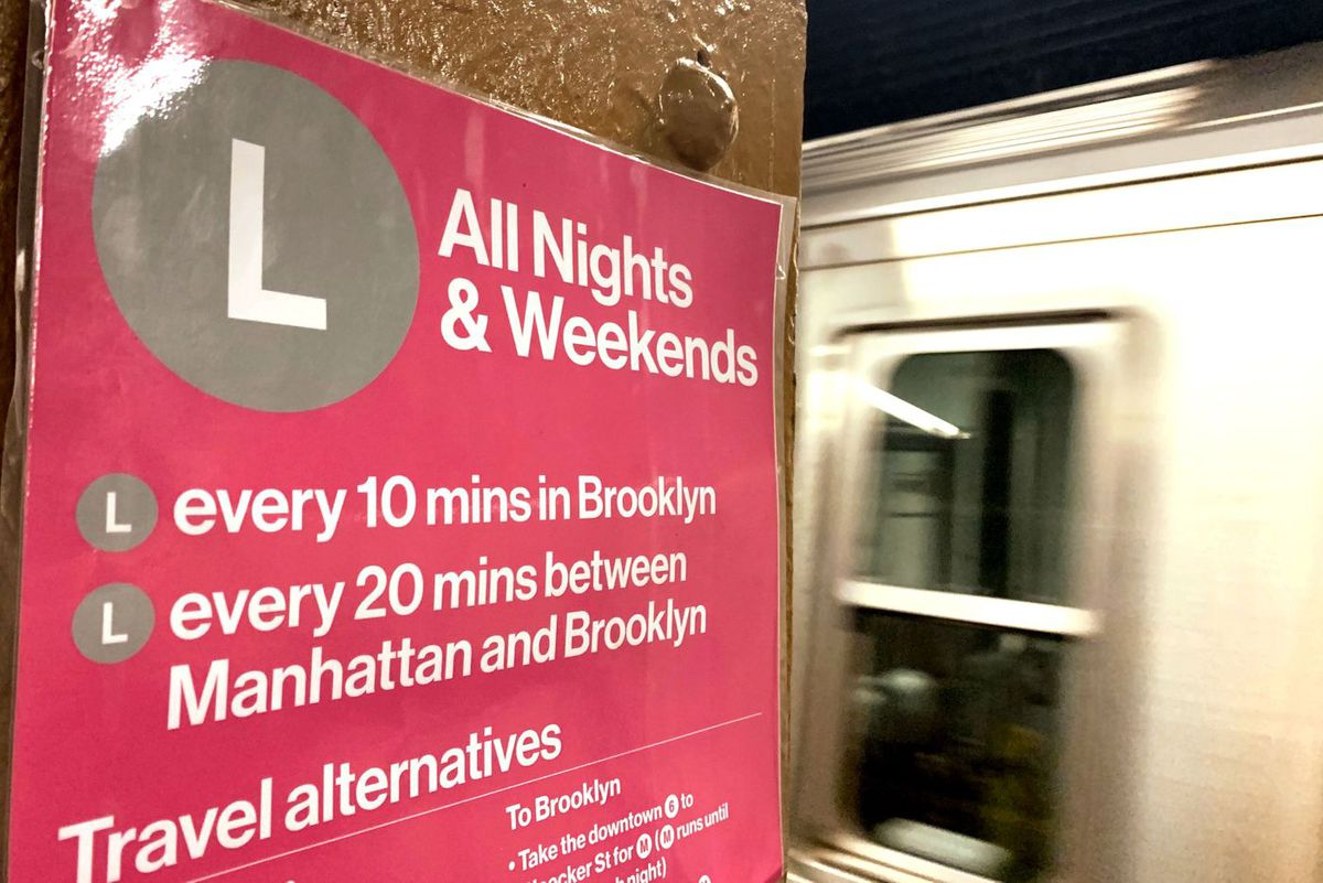 An MTA sign detailing service delays on the L line.