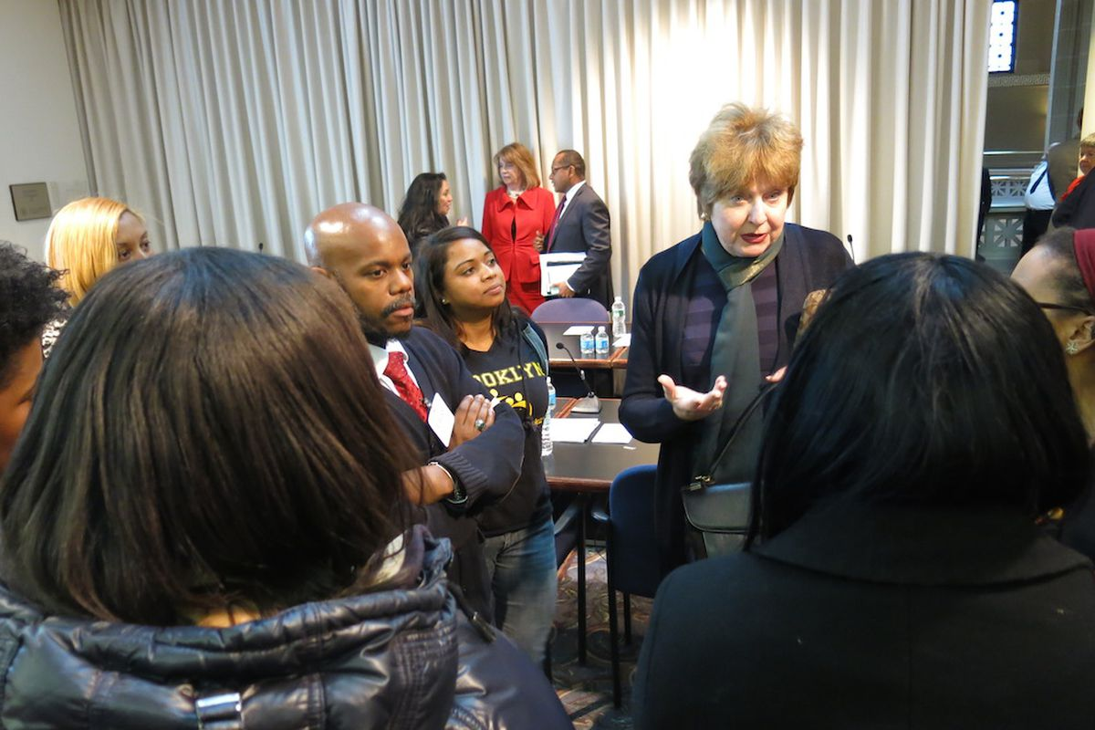 Teaching Firms of America co-founder Rafiq Kalam Id-Din, with parents and staff of the school, speak with Regents Kathleen Cashin in Albany after a meeting about charter school authorization in 2014. In a rare move, Regents said they would not approve a spate of charter school renewal recommendations submitted to them by the city's Department of Education because they lacked consistency.