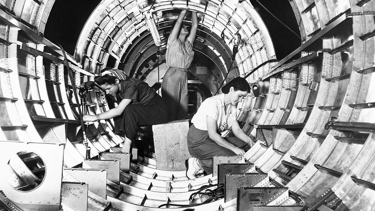 Workers assemble the tail fuselage of a B-17F bomber at the Douglas Aircraft Company in Long Beach, California, circa 1942.