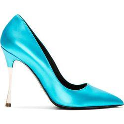 "<b>Nicholas Kirkwood</b>, <a href=""https://www.ssense.com/women/product/nicholas_kirkwood/blue-metallic-leather-pointed-pumps/97666"">$209</a> (from $695)"
