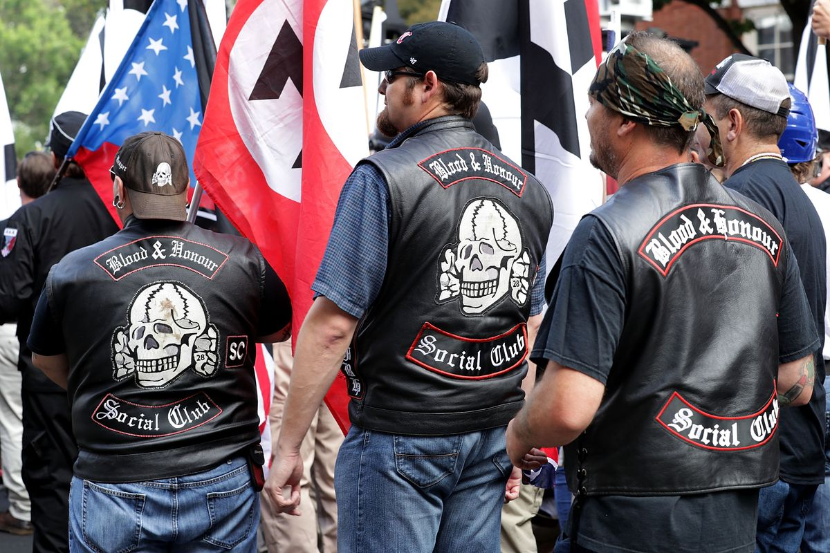"""Members of the Blood & Honour Social Club, wearing black leather vests, participated in the """"Unite The Right"""" rally In Charlottesville, Virginia"""