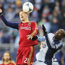 Real's Luis Gil and Kansas City's Lawrence Olum battle for the ball as Real Salt Lake and Sporting KC play Saturday, Dec. 7, 2013 in MLS Cup action.