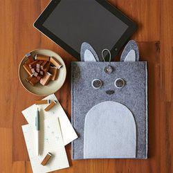 "For the cutesy techie:  Felt Bunny Tablet Holder, <a href=""http://www.westelm.com/products/felt-bunny-tablet-holder-d238/?pkey=cgifts-25-under"">$9.99</a> at West Elm"