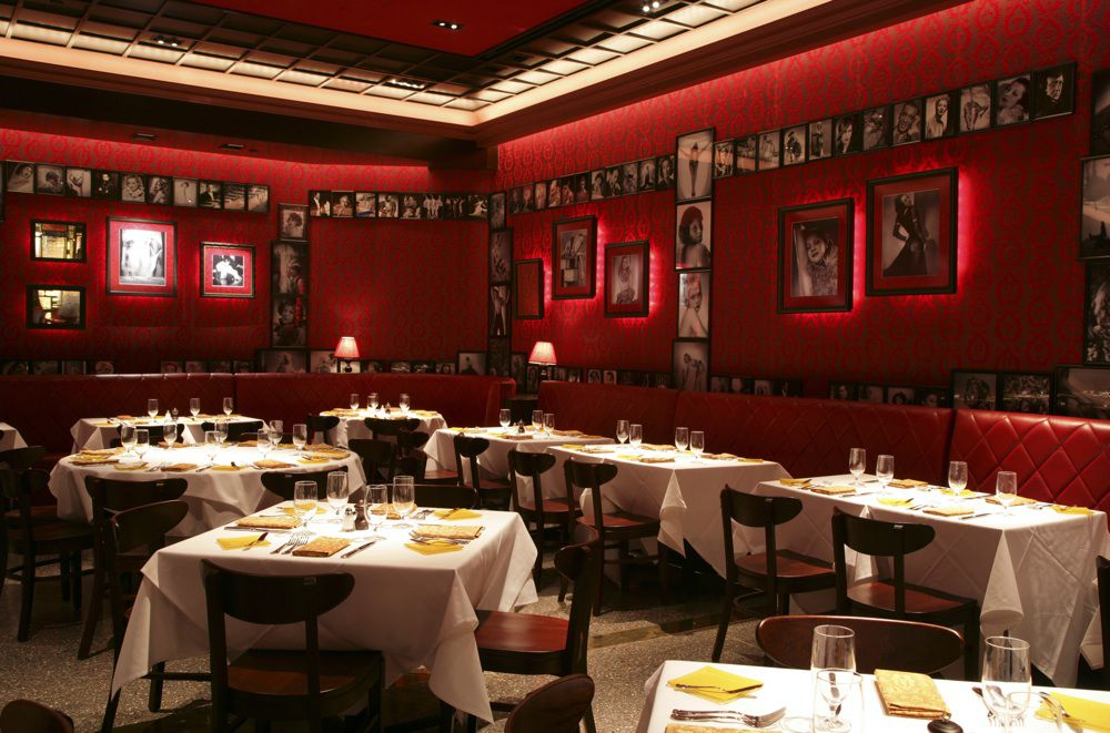 Dim restaurant interior with red furnishings