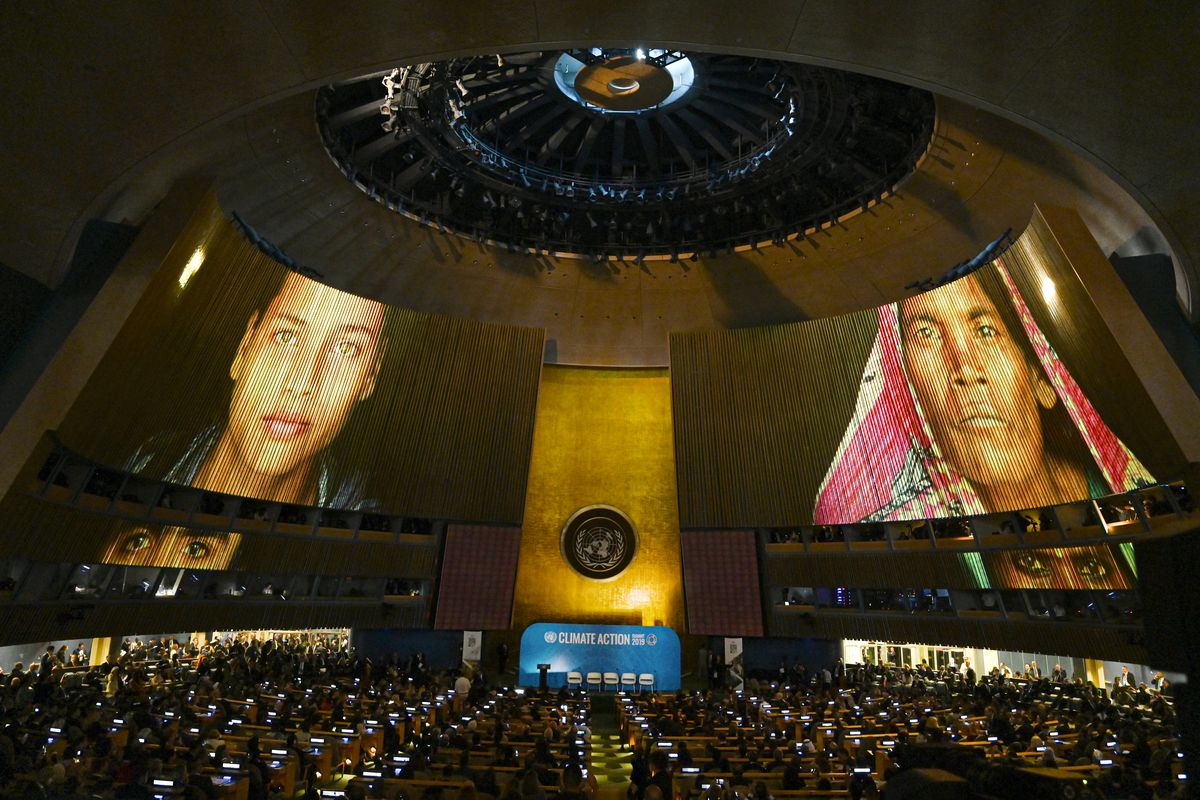 The United Nations General Assembly Hall displays faces from around the world on its huge screens during the Climate Action Summit 2019.
