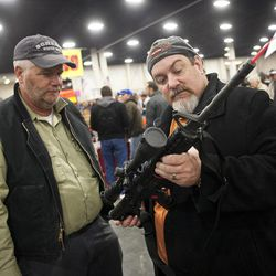 Gun owners discuss a potential sale of an AR-15, one of the most popular and controversial weapons at the South Towne Expo Center during the 2013 Rocky Mountain Gun Show, Saturday, Jan. 5, 2013.