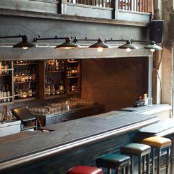 The main bar, with repurposed ship yard lights overhead.